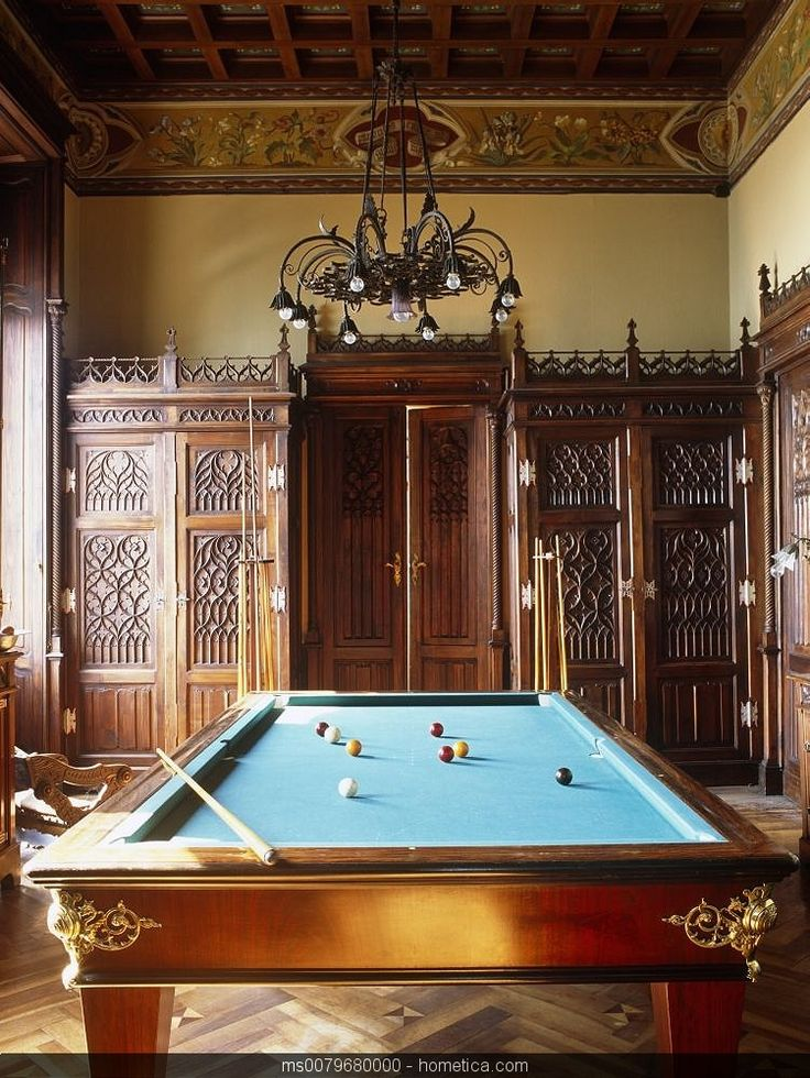 traditional mediterranean game pool table room with wood carved panels and door traditional chandelier, walls with fresco   painting and wood carved ceiling and mosaic wood floor