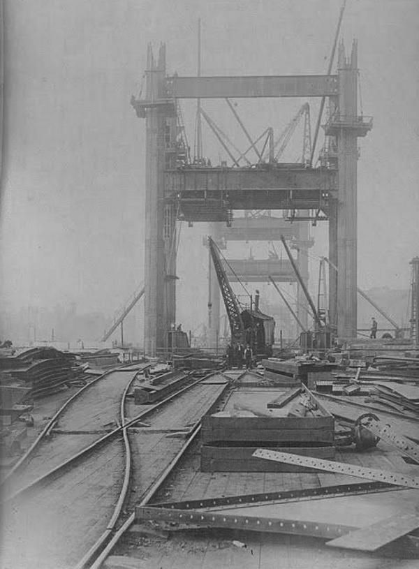 An extremely early photo of the construction of Tower Bridge