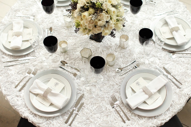 White wedding rosette linens with bling accent napkin rings