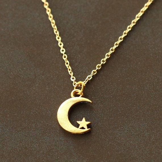 Crescent moon necklace, gold tiny moon and star necklace, moon pendant, Modern, Cute, Everyday Necklace, Gift for sisters, Mothers    -The moon charm size: 17mm*11mm.    - 14K Gold plated Copper chain. The charm is made of alloy.    Handmade time: 1-3 days( time from payment to shipment)  Payment: Paypal or Credit Card accepted    Jewelry tarnished over time by everyday wearing or bathing is not returnable, refundable or replaceable. All plated materials are not solid precious metals and…