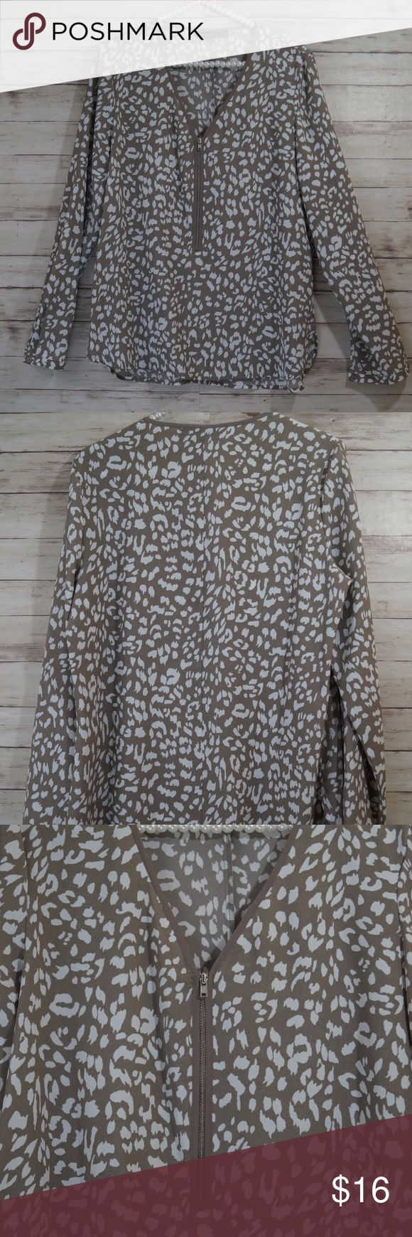 APT 9 Animal Print Zip up Blouse Size M Size: Medium Bust: 20 inches laying flat Length Front: 25 inches Length Back: 27 inches  Condition: In Great condition!  Please ask all questions prior to purchase since all sales are final!  Thank you. Apt. 9 Tops Blouses