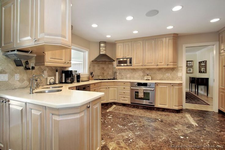 A Traditional Kitchen Featuring Whitewashed Maple Wood Cabinets, An Island  With Fabric Stools, And A Mosaic Tile Backsplash   Kitchens Of The Day ...