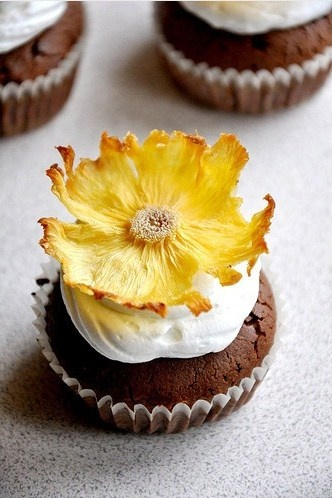 Torched flowers - Baked pineapple slices in muffin tins.
