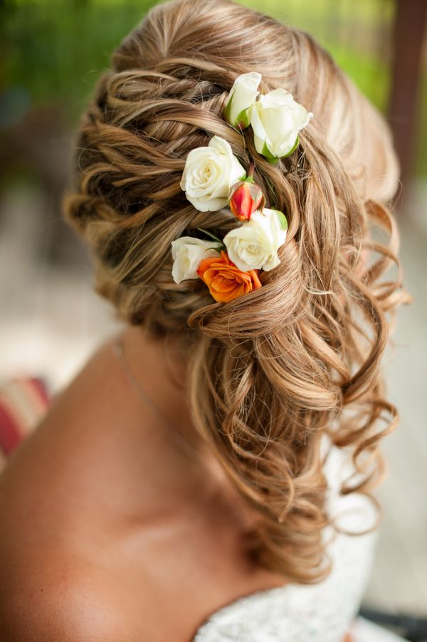Braided hair with rose buds | Photo by Claire Pacelli Photography