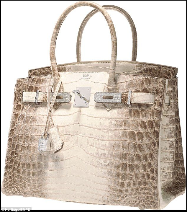 Reptilian: The bag is encrusted with 245 diamonds, boasting 18-karat white gold hardware. ;) only Herm`es!