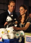 CULVER CITY, CA - JULY 10: Prince William, Duke of Cambridge and Catherine, Duchess of Cambridge help pack care packages for military children at the Mission Serve: Hiring Our Heroes event on July 10, 2011 in Culver City, California.