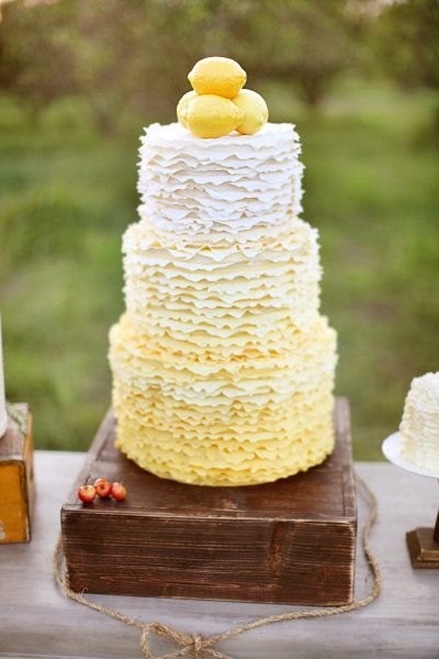 Lemon Wedding Cake. Frilly little white and lemon tinted frills. Topped with, well, lemons. Great rustic box and bow, too. (Would look fab with a milk glass base as well). www.facebook.com/LFFdesigns