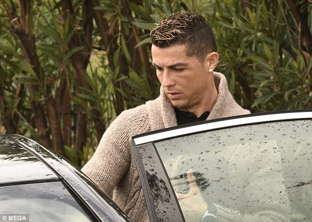 Cristiano Ronaldo and Georgina Rodriguez in Marbella  He is at the centre of allegations that he sent glamour model Rhian Sugden a barrage of late night texts.  And Cristiano Ronaldo appeared subdued as he arrived at a Marbella beach club on Sunday putting on a close display with his current girlfriend Georgina Rodriguez.  The footballer 32 was there to celebrate Georginas 24th birthday placing a protective hand around her shoulder as they arrived.  Scroll down for video  Sombre: Cristiano…