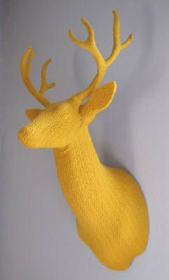 Hand-knit yellow deer head trophy by Rachel Denny