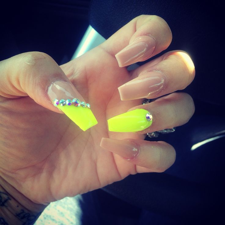 Loving my nails!! Neon yellow n classic nude