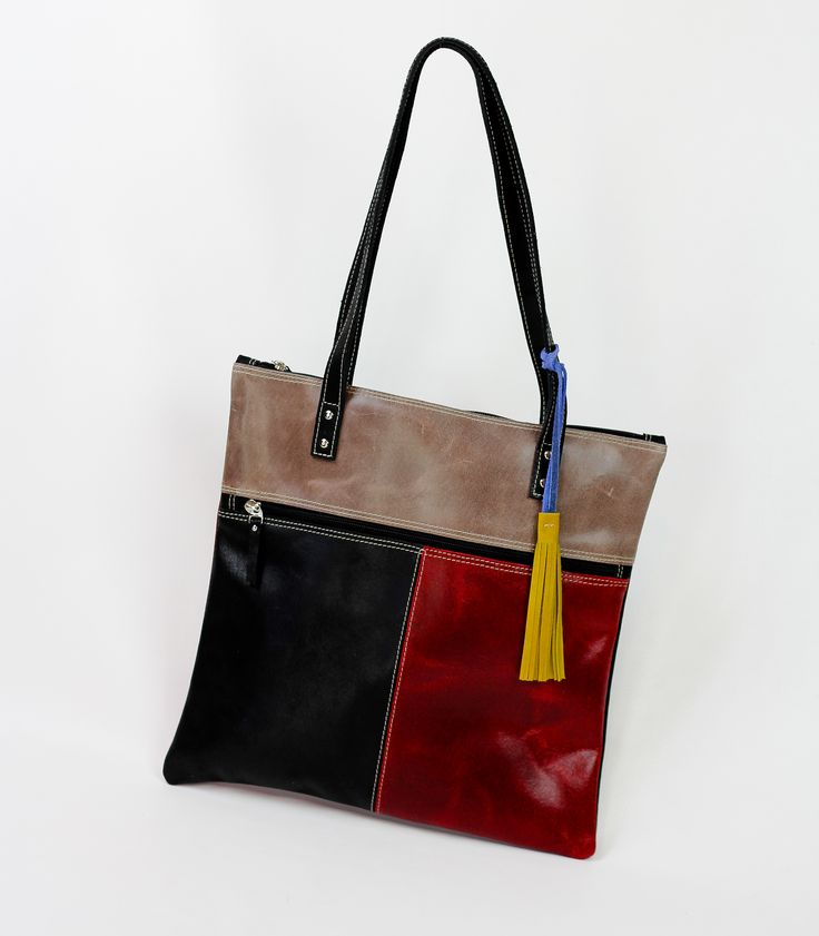 """PRODUCT INFO      This vintage style genuine leather handbag features:          * Zipper Closure         * Handmade         * Dimensions Length 13.78"""" Width .4"""" Height: 13.78""""         * 1 Inside and outside zipper compartment         * Double Shoulder Strap (11"""" to midpoint)      Carry every day items; Cell phone, keys, make up among other items."""