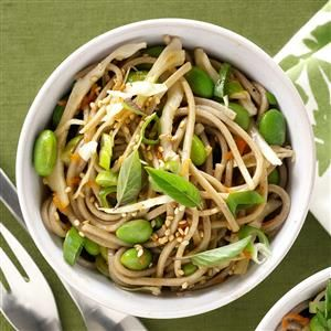 Soba Noodles with Ginger-Sesame Dressing Recipe -We love when opposites attract. A sweet and sour gingery dressing goes hand in hand with soft Soba noodles, edamame and crunchy slaw. If you're not vegetarian, add grilled shrimp or chicken for a protein-packed finish. —Mandy Rivers, Lexington, South Carolina