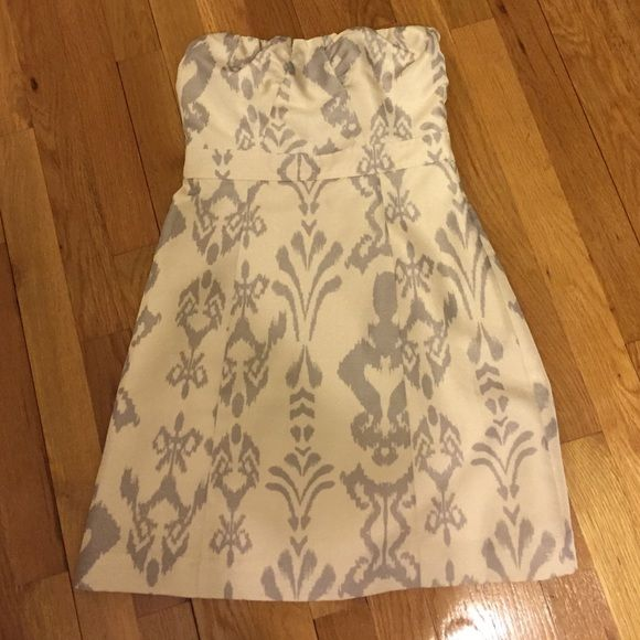 American Eagle Outfitters Holiday Strapless Dress Beautiful Brand New Creme and Silver strapless creme dress. New with tags. Size 2. Great for the holidays! Fits true to size. American Eagle Outfitters Dresses Strapless