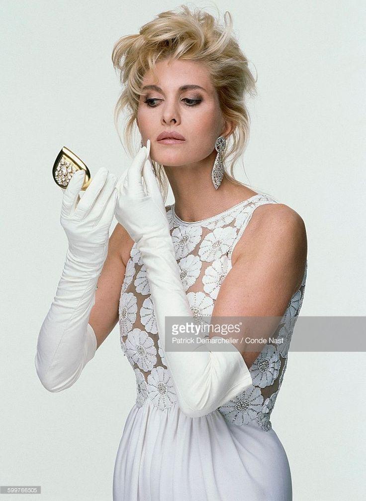 News Photo : Socialite Ivana Trump wearing a white silk and...