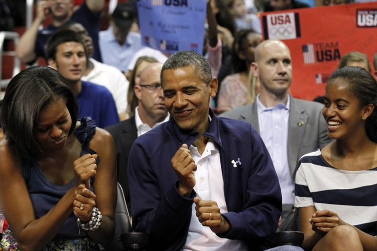 The Obamas dance in their seats at a U.S. Men's Olympic basketball team game in July 2012.