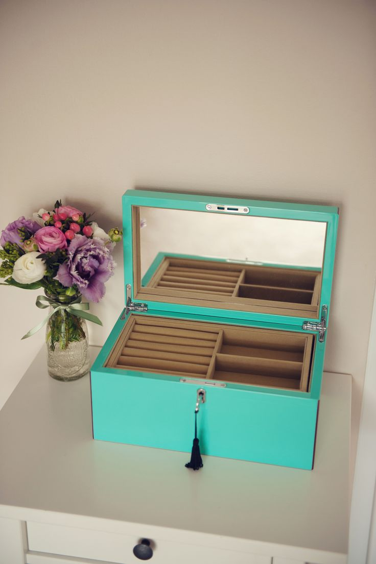 Jewellery Box - One of my favourite items in my bedroom! It's pretty in a timeless Tiffany blue colour, chic and keeps your delicate jewellery nice and organised.