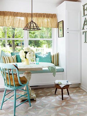 Love the window seat for smaller eat-in kitchen areas. Plus, the flooring