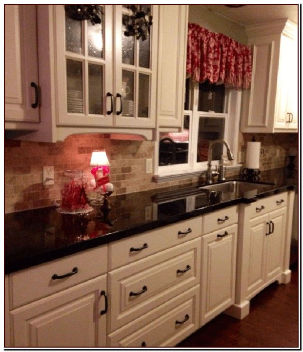 Black Countertops With Dark Brown Cabinets Black Countertops With Dark Brown Ca In 2020 Antique White Kitchen Antique White Kitchen Cabinets New Kitchen Cabinets
