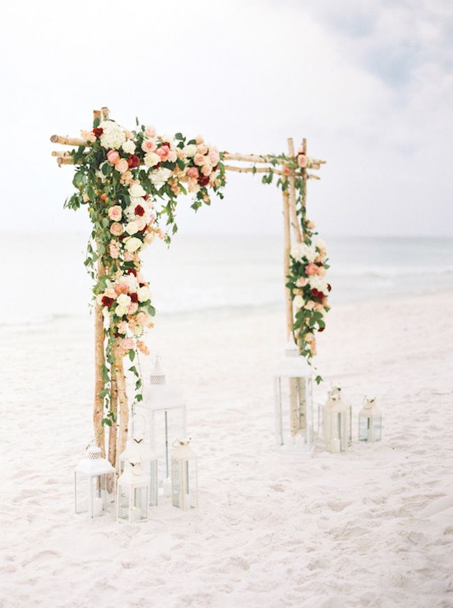 Birch wedding ceremony arch with flowers. To-Die-For Beach Wedding Ceremony Arches on Here Comes The Guide!