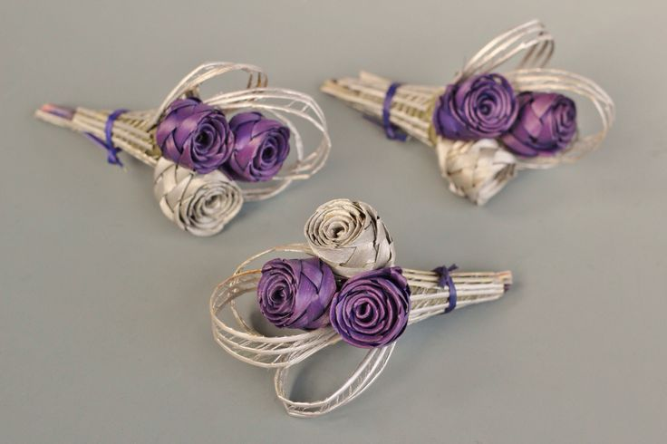Three bud flax buttonhole in purple and silver.  www.flaxation.co.nz