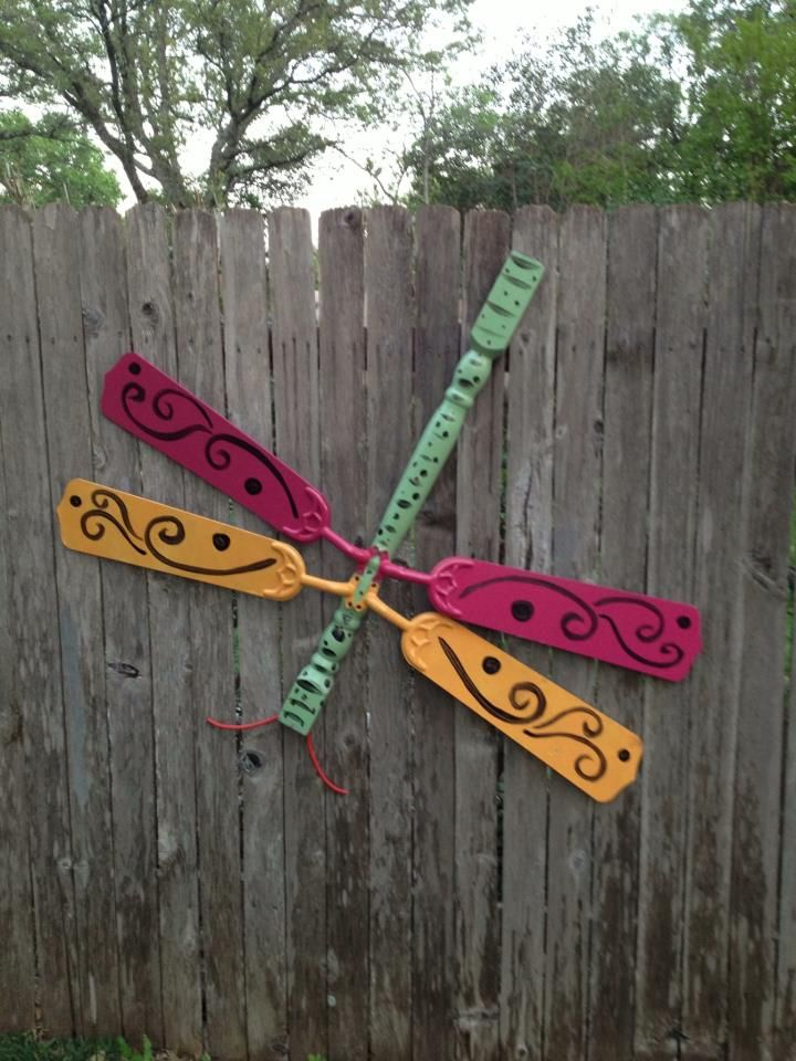 My daughter made some backyard art - a dragonfly - out of a table leg and old ceiling fan blades.  Cute yard art.