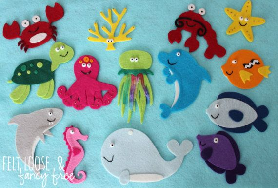 14-piece Under the Sea Felt Story from Felt Loose & Fancy Free. Featuring a whale, dolphin, octopus, shark, jellyfish and more! Felt board story sets that promote literacy, imagination, and learning - all in one playful pouch! www.etsy.com/shop/FeltLooseFancyFree #felties #feltboard #woolfelt
