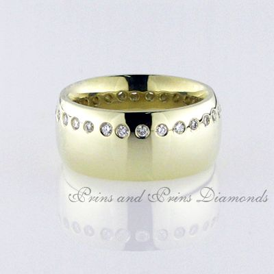 There are 32 = 0.48ct GH/VS – SI round brilliant cut diamonds swiss set on the one horizontal side of an 18k yellow gold chunky ring