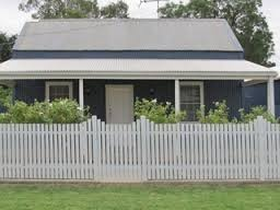 Weatherboard House with Picket Fence
