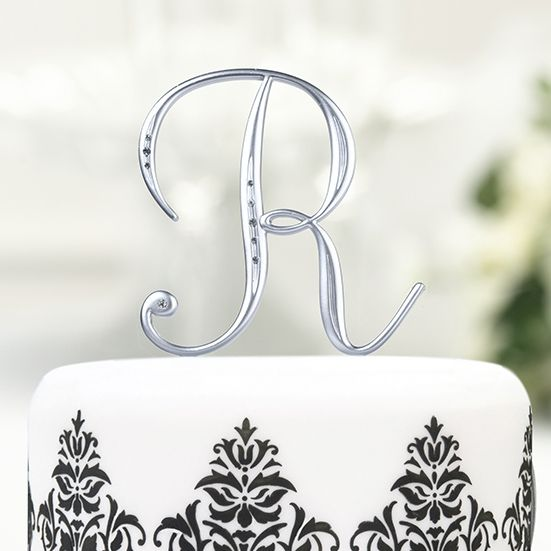 Create your own unique monogram initial cake topper with these large individual 4 1/2 inch tall silver monogram initial cake topper picks.  Featuring a matte silver finish with clear sparkling rhinestone embellishments, these large cake picks are available in all 26 letters of the alphabet to create single or multiple letter monograms on wedding cakes, anniversary cakes and birthday cakes.