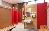 Changing room at St Mary's College Designed by RGC. Laminex HPL Olympia Red and Laminex Natural Timber Veneer Tasmanian Ash/Oak