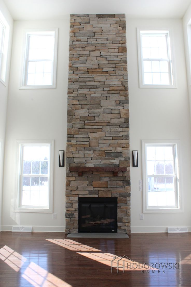 One of our favorite fireplaces from Twenty West: A cultured stone 2-story fireplace with a stone slab hearth and a floating mantel shelf.