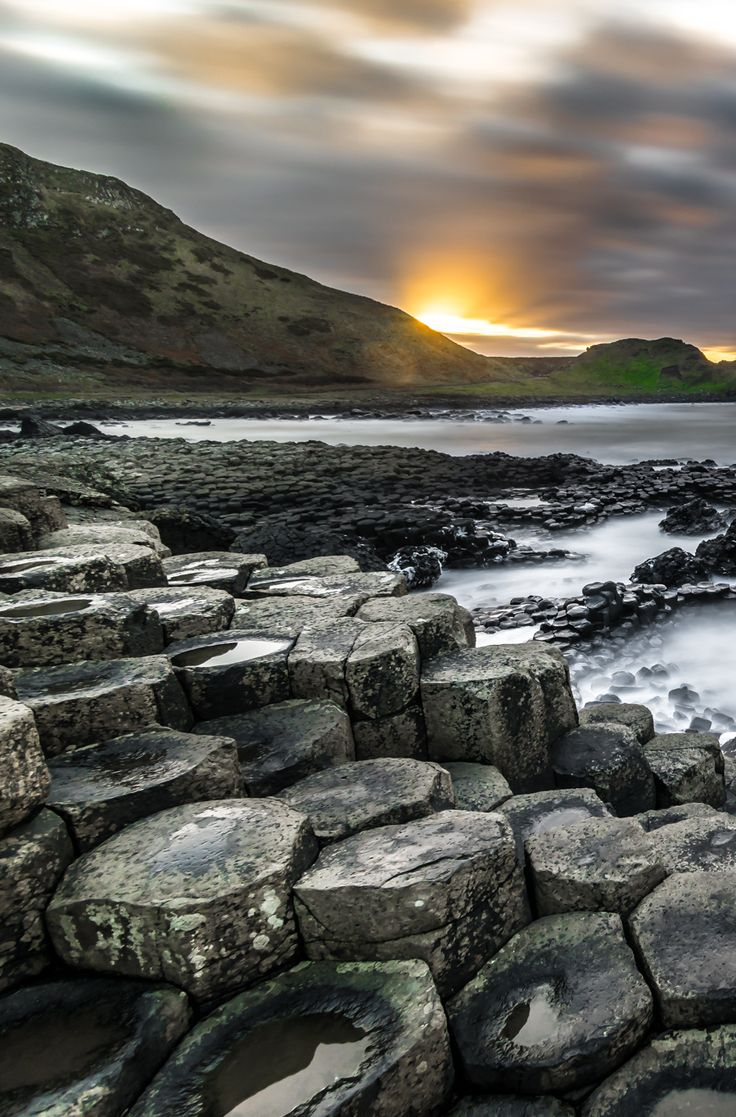 One of the top ranked tourist sites in Northern Ireland, the Giant's Causeway is a dramatic sight!! Check out how to get there with this post. #travel #Ireland