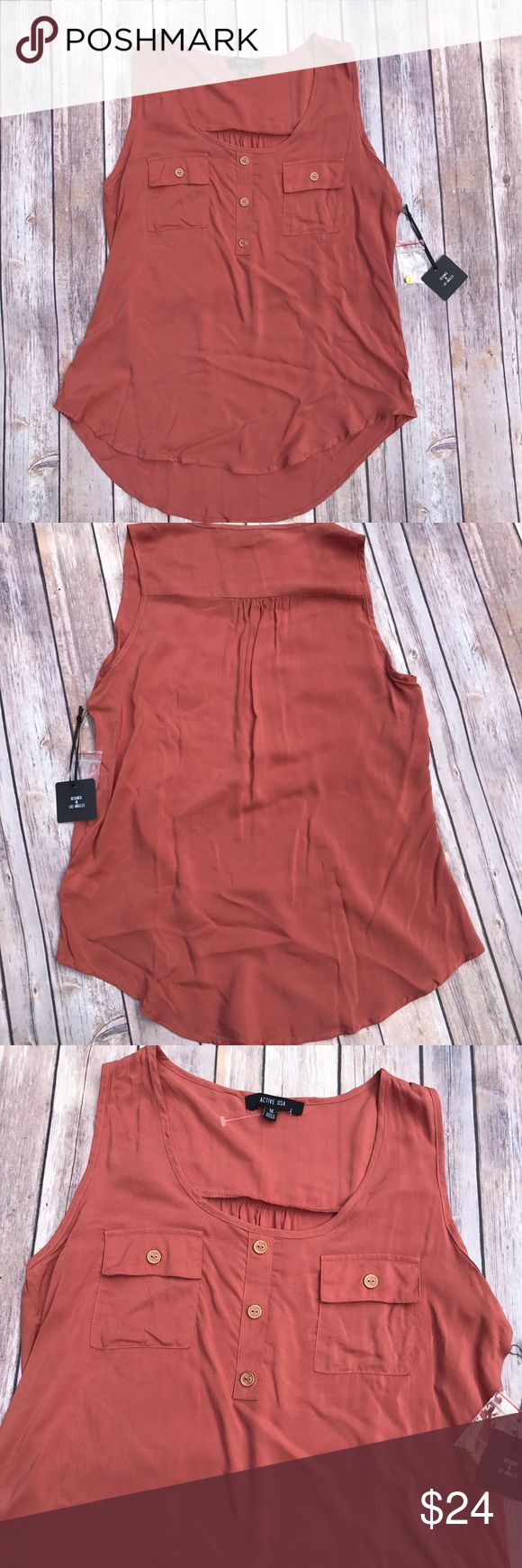 Active USA Sleeveless Top Size Medium. Brand new with tags. Material is 100% Rayon. Top was designed in Los Angeles. Perfect staple piece! Bundle with additional items for a 20% discount. Active USA Tops