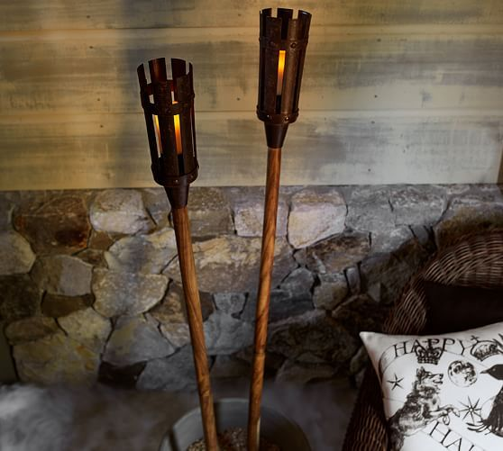 Medieval Torch, Set of 2 | Pottery Barn. Staked in the ground or held aloft, our big, bold and bright tiki torch lights the way for Halloween callers. Medieval Halloween Game of Thrones Gathering.