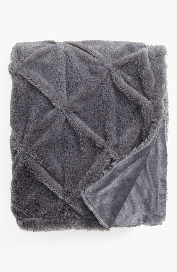 TEXTURE. DEF: Creates feelings for the room. WHY? You can see how soft the blanket is!