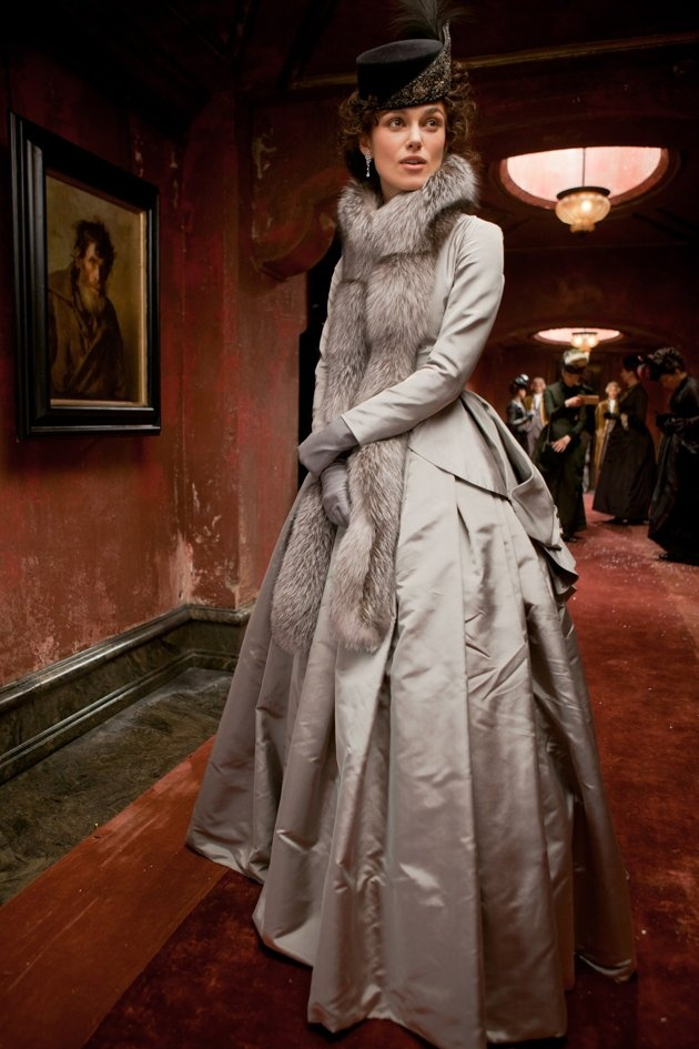 The hat is gorgeous. All millinery is designed and made by Sean Barrett. The elegant, silver-gray jacket and skirt with long silver fox stole and gray gloves is worn in the film during one of Anna's outings with Vronsky