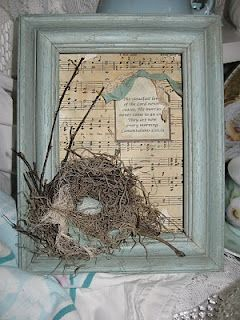 bird nest at Christmas...Christmas carol music sheet for background.