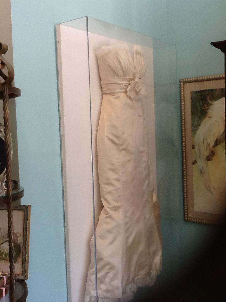 This is my framed wedding dress in a shadow box. You can see it at my store in fort lauderdale, florida 33306