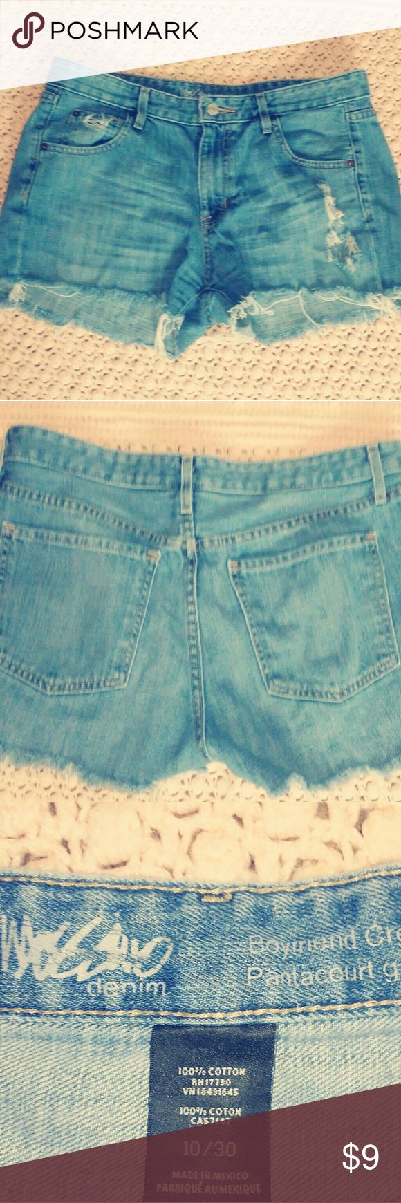 × Destroyed Denim Cut Off Shorts × Mossimo Destroyed Denim Cut-Off Shorts in a beautiful light wash... Perfect for the upcoming summer months. Super hot with a crop top or just a cute tee. These are not low rise. I'd say mid to high rise depending on how high you wear them..size 30 or 10.  Very cute small rip on front right leg and fraying from being cut offs of course. Super cute!!! Bundle to save a lot!!! $7 on M erc ari Mossimo Supply Co Shorts Jean Shorts