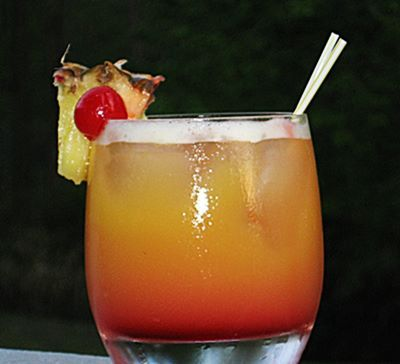 Day at the Beach  2 oz. Malibu Coconut Rum 1 oz. Amaretto 4 oz. Orange Juice .5 oz Grenadine Pineapple Wedge and/or Cherry to garnish