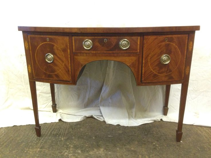 Regency bow fronted sideboard with satinwood inlay on tapered legs