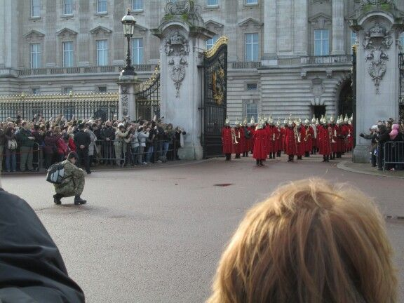 london buckingham place, changing of the guard, serviceman allowed to photograph from the clear area directly in front