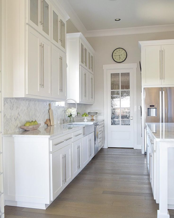 Gorgeous white kitchen with white carrara marble and white for Small white galley kitchen ideas