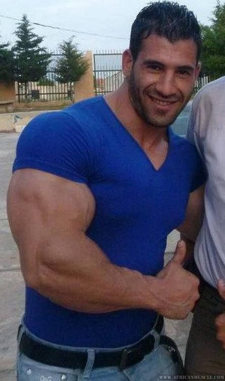 What could be more sexy than a handsome hunk filling out a tight shirt, his muscles stretching the seams as he flexes. Muscle heaven.