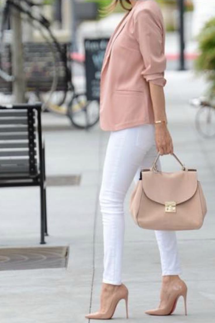 Obsessed this casual office work outfit for women for spring looks trendy and chic. The blush blazer paired with the white pants looks perfect. I love the nude pumps and matching nude tote bag will have you feeling and looking like a million bucks even on a Monday work day.