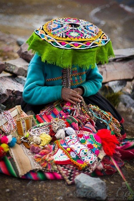 Peruvian woman in beautiful textiles. This is backbreaking work! The older generations do not like to be photographed, they think cameras/pictures rob their soul.