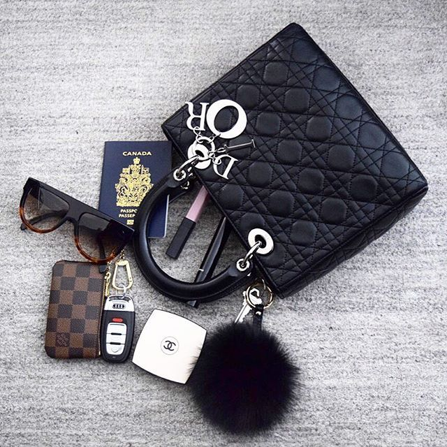Instagram media sj_luxe - #whatsinmybag Lady Dior Bag with some goodies inside: Celine sunglasses, Louis Vuitton key pouch, Fur Pom... Website coming soon