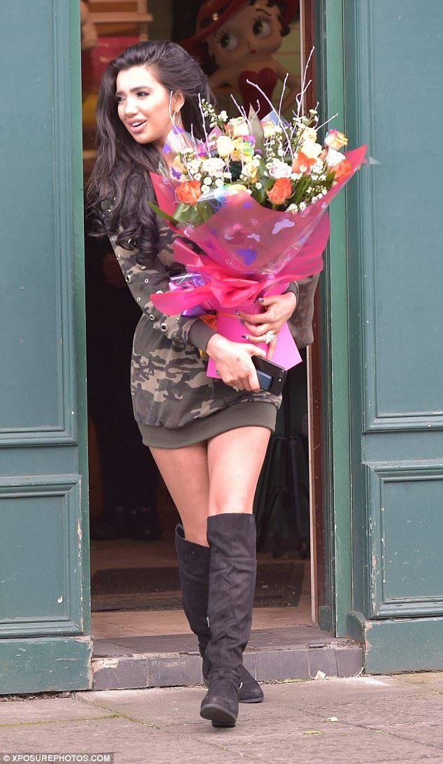 Flower power! The 25-year-old Celebrity Big Brother and X Factor star kept things simple in a camouflage jumper dress paired with sexy thigh-high boots while cinching in her tiny waist with a corset-style belt over the top
