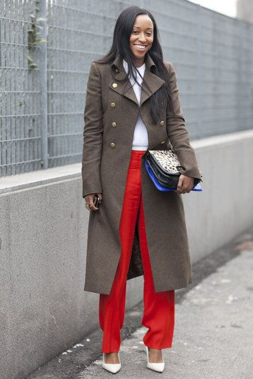 Fashion Week - Street Style - White Pumps: Shiona Turini made a cool-girl play on green and red in an olive military coat and bright pants — with sleek Spring-white pumps to finish.