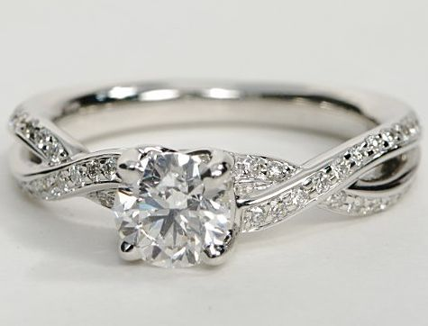 This dazzling engagement ring features a beautiful 14k white gold band with a unique twisted design and pave diamonds providing extra sparkle. Pick your center diamond (must be round) to create an amazing engagement ring.
